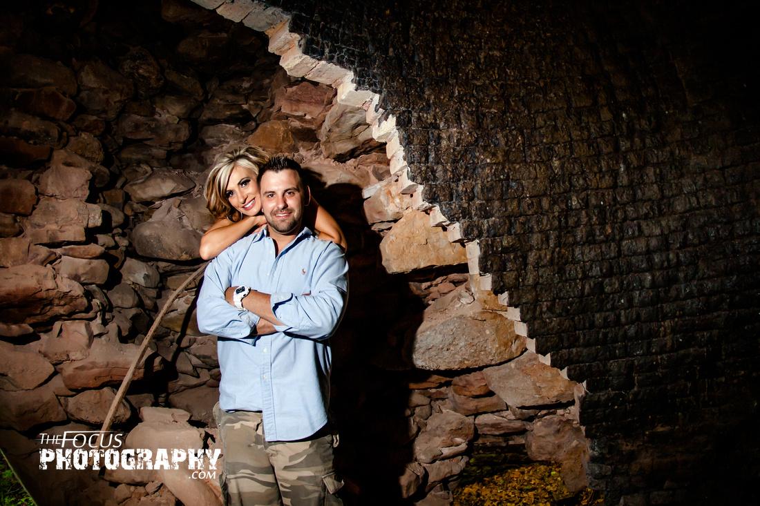 Couple portrait stone wall