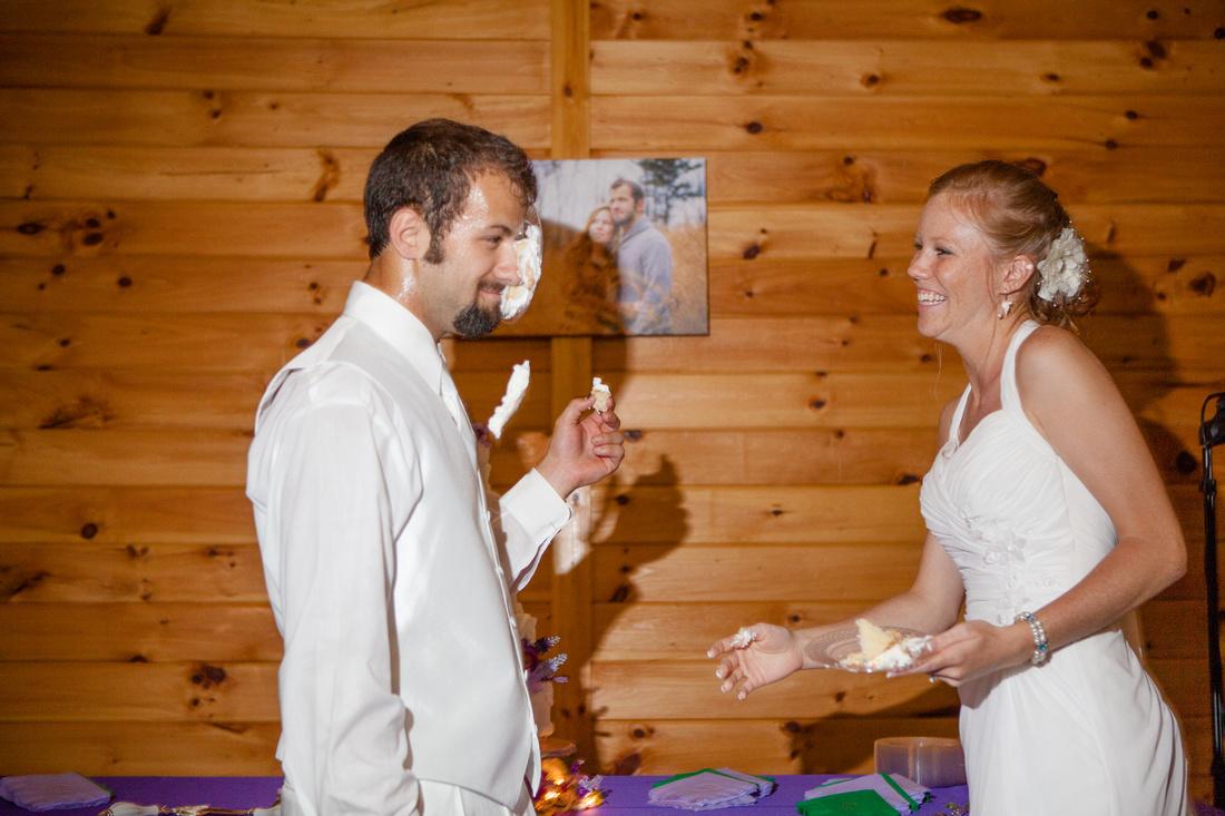 cake in grooms face outdoor wedding photography harrisburg central pennsylvania rose finley the focus photography