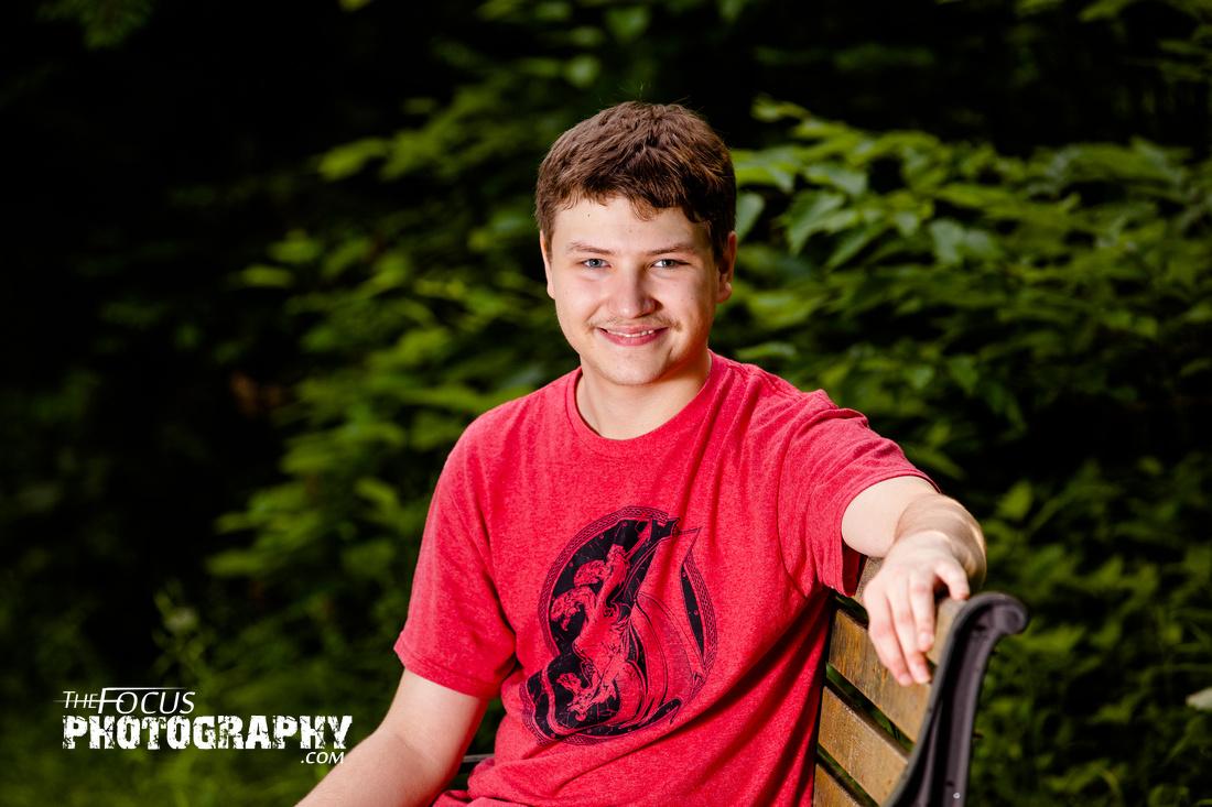 boy senior portraits in the woods