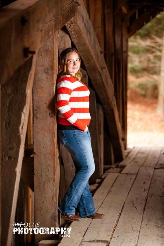 fall senior portrait in covered bridge