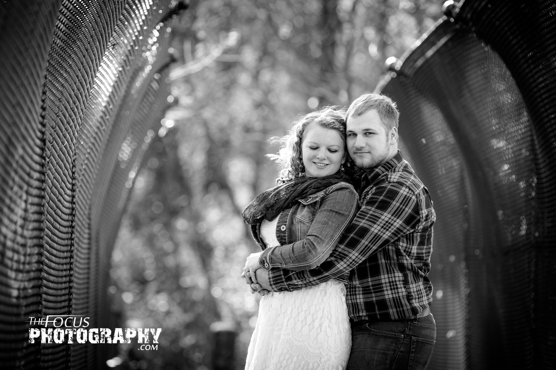 fall engagement photo on bridge black and white