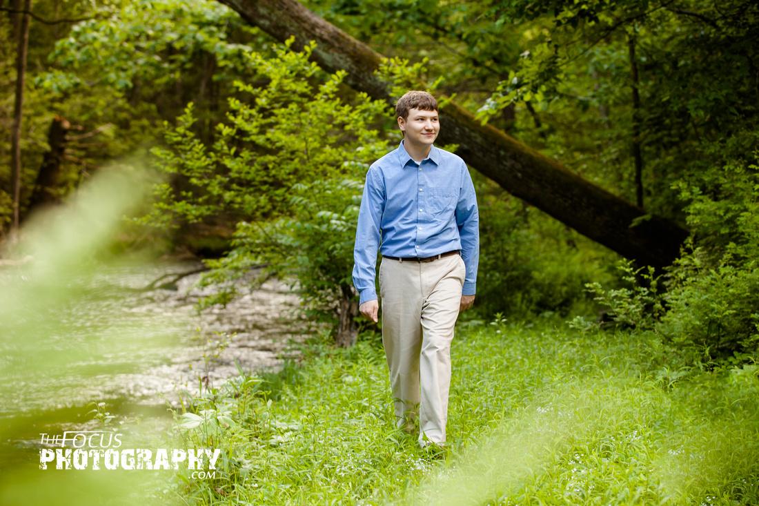 boy senior portrait in the woods