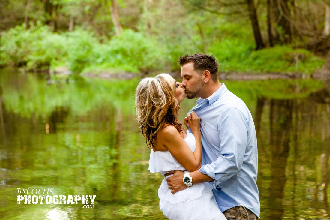 Couple portrait in a creek