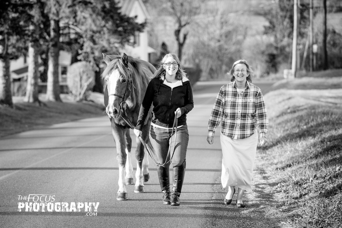 girl and her mom taking her horse for a walk