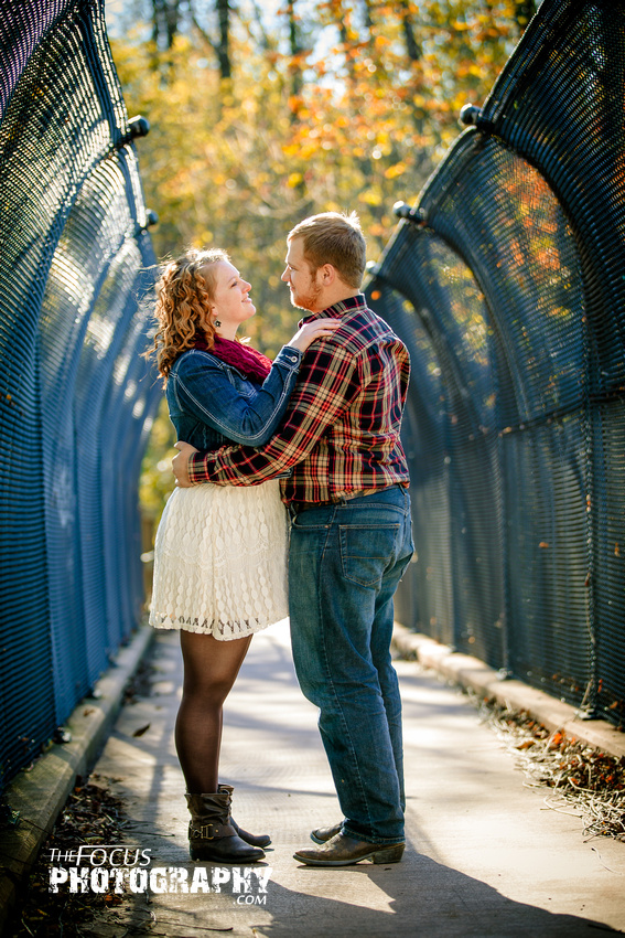 fall engagement photo on bridge