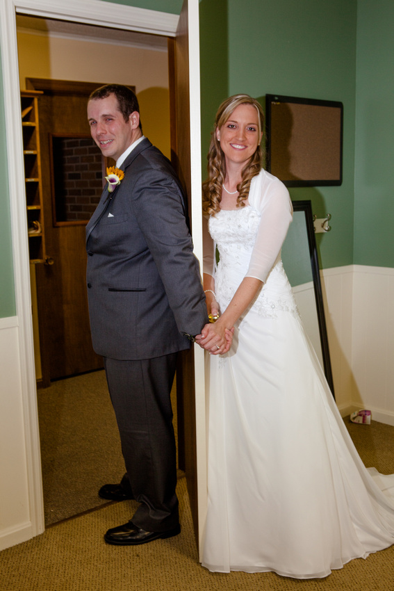 bride and groom on the other side of the door