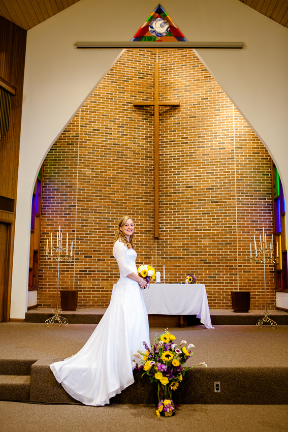 The bride in front of the church