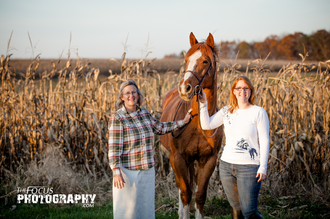 mother daughter a girl and her horse in a corn field