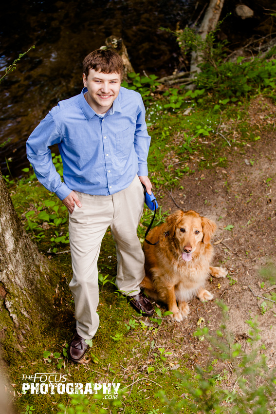 boy senior portraits in the woods with golden retriever dog