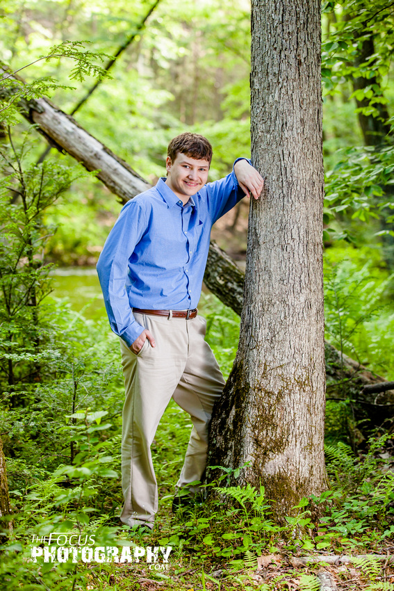 boy senior portraits in the woods