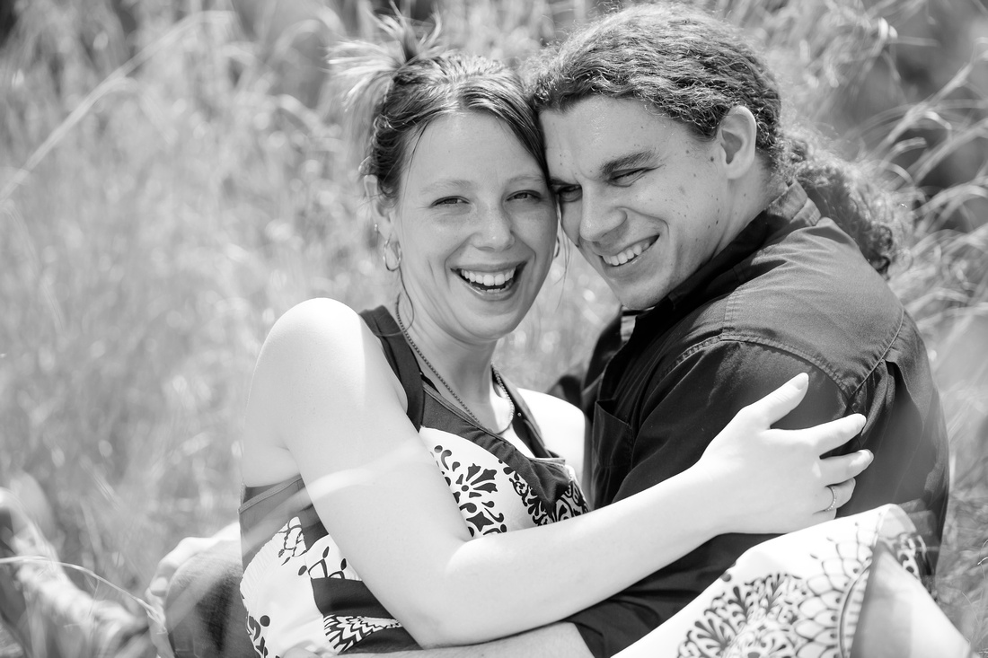 engagement photo session couple sitting in field dauphin Pennsylvania