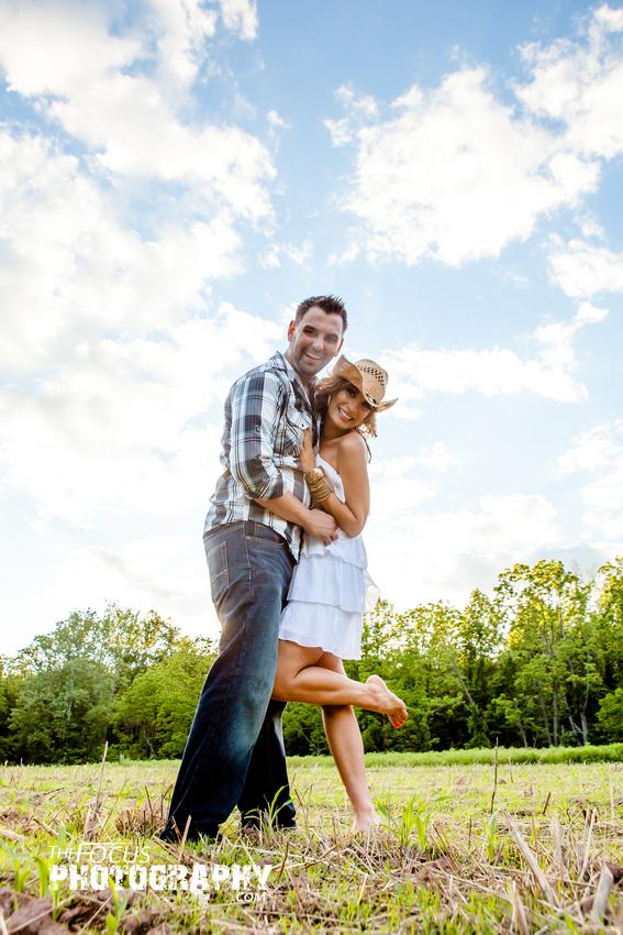 Couple portrait in a field
