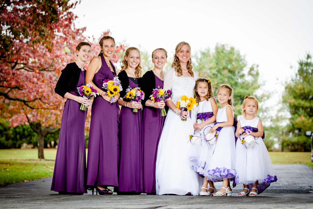 bride with brides maids and flower girls