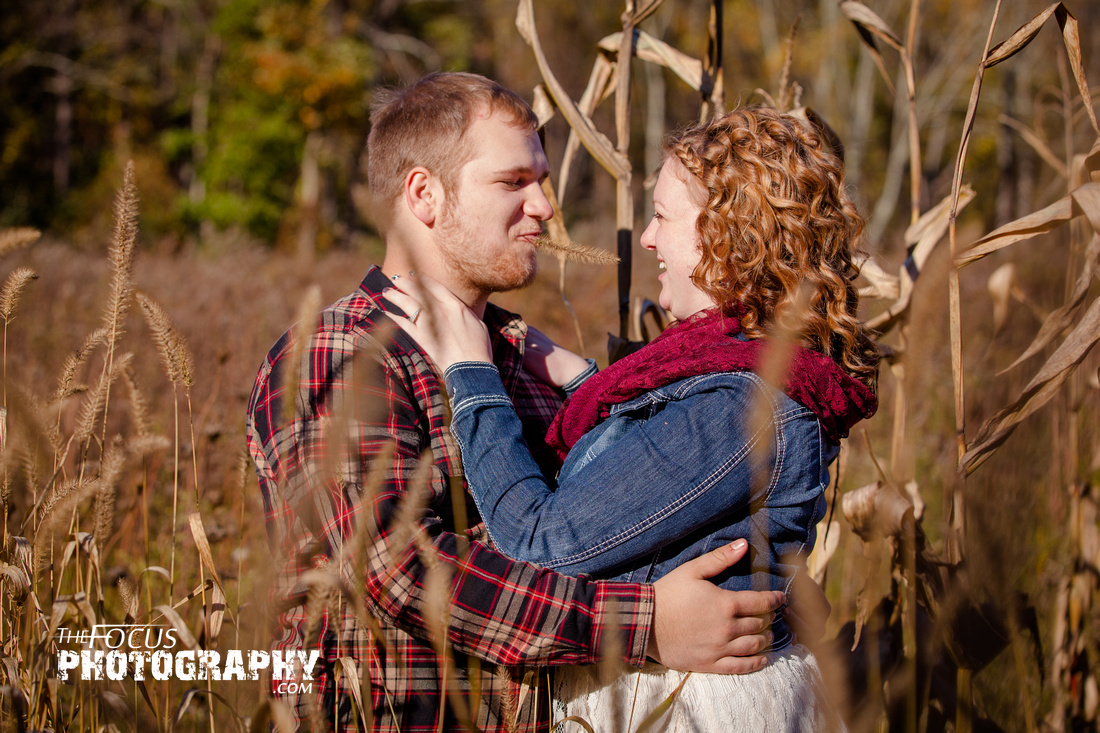 fall engagement photo in a field