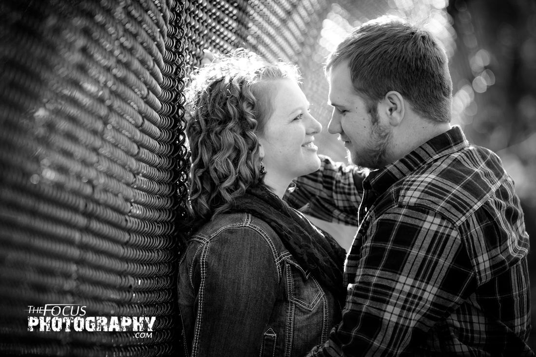 fall engagement photo on bridge